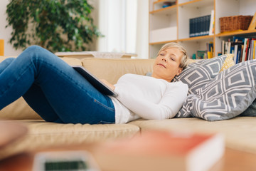 Mature woman relaxing sleeping midday