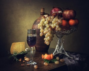 Still life with fruits and red wine glass