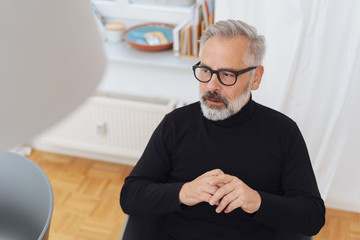 Middle-aged man thinking or planning a new project