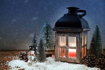 Lantern with Christmas trees. Christmas card.