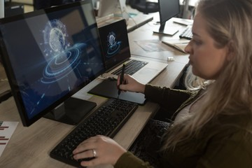 Executive using graphic tablet at desk