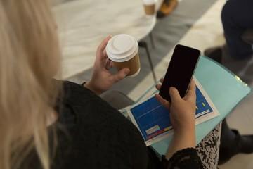 Female executive using mobile phone