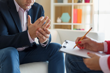 Man meeting counselor for marriage consultation