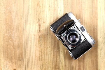 old camera,  on a wooden table with copy space