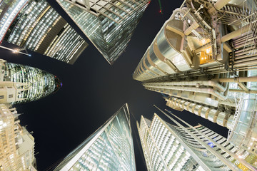 Looking directly up at London financial district skyline at night