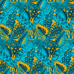 Beautiful seamless pattern with ropical jungle palm leaves.