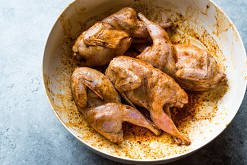 Raw Quail Meat with Sauce Ready to Cook in Bowl.