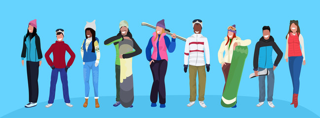 Wall Mural - mix race skiers snowboarders holding equipment happy people wearing winter clothes vacation activity concept male female cartoon character full length flat horizontal