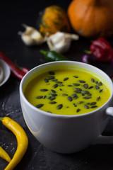 Pumpkin asian coconat cream soup. Autumn hot food