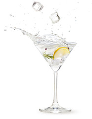 Deurstickers Cocktail ice cubes falling into a gin martini cocktail splashing on white background