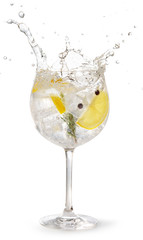 Fotobehang Cocktail gin tonic garnished with lemon and rosemary splashing on white background