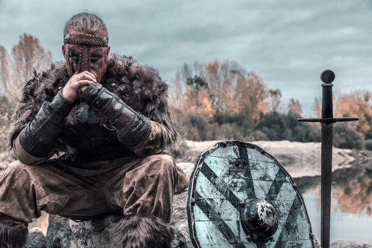 fierce viking warrior wounded in battle