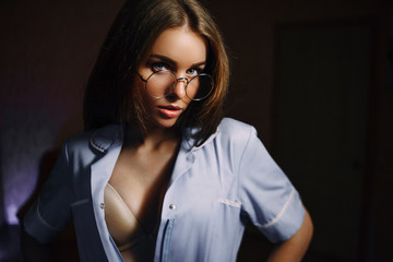 Girl spectacled, in the suit of train nurse