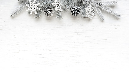 Christmas white Fir tree branches with white decorations.