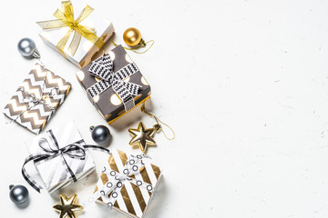 Black, silver and Gold present box and decorations on white.