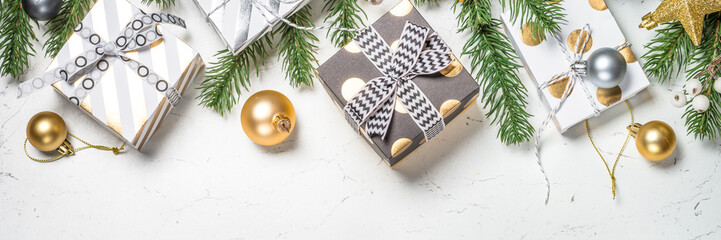 Christmas background with Gold and white present box and decorat