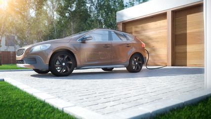 Modernes Elektroauto zu Hause Strom tanken braunes SUV
