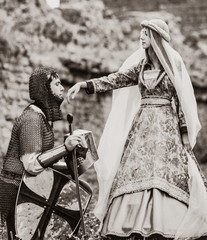Knight and medieva lady at outdoor. Image in black and white color style
