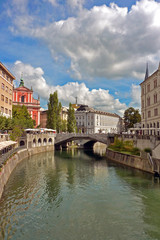 Ljubljana seen through the River Ljubljanica, with the Triple Bridge in the distance