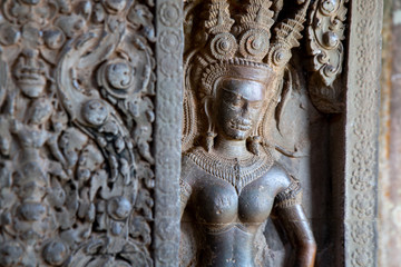 Sculpture of Apsara by Stone carving of angels on the wall of Angkor Wat in Siem Reap, Cambodia
