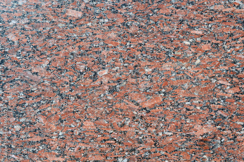The flat surface of a natural marble or brown granite slab