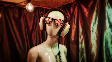 Hypnotic glasses and vintage headphones on a female mannequin.