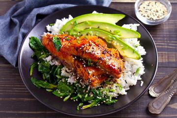 Salmon teriyaki rice bowl with spinach and avocado.
