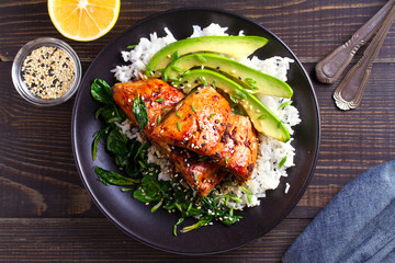 Salmon teriyaki rice bowl with spinach and avocado. View from above, top studio shot Wall mural