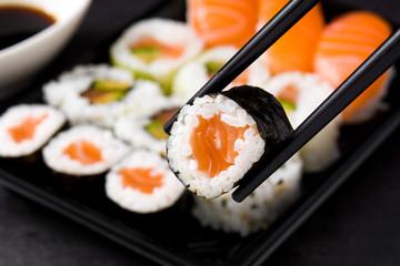 Fototapeta sushi and chopstick on sushi pack background obraz
