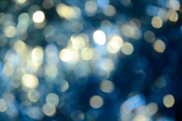 Bokeh photo. Holiday background. Christmas lights. background. Defocused sparkles. New Year backdrop. Festive wallpaper. Blinks. Carnival. Retro style photo.
