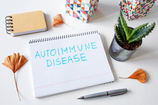 Autoimmune disease written in a notebook on white table