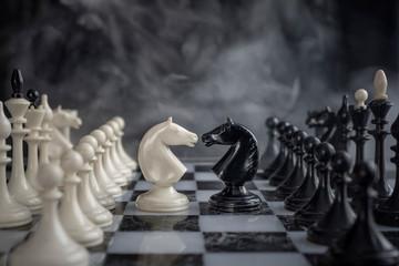 Chess knights head to head.
