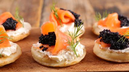 bread with cheese, salmon and caviar