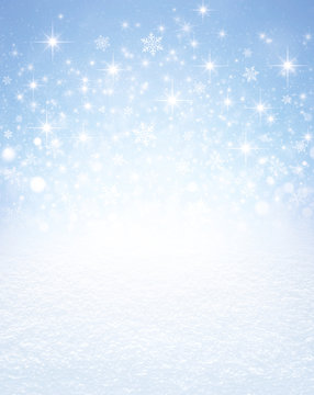 Snowflakes and stars on a winter snow covered ground