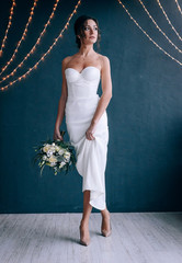 happy and young bride in a gentle dress in eco style.