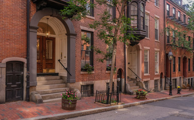 Acorn Street in Beacon Hill district, Boston, Massachusetts, USA - July 28, 2018: Entries of mansions in the Beacon Hill district in the city of Boston