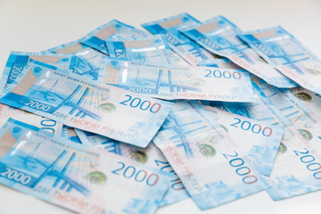Background Of Paper Russian Money. New Russian Banknotes Of 2000 Two Thousands Rubles.
