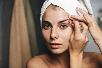 Pretty young woman with towel on head