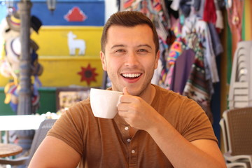 Handsome man enjoying a cup of coffee