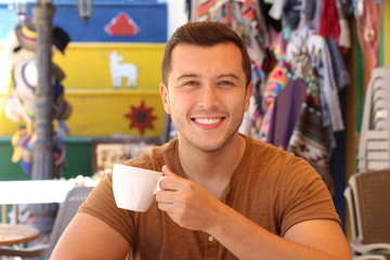 Attractive man enjoying a cup of coffee