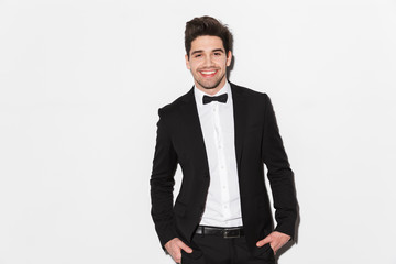 Portrait of a smiling young man wearing black suit