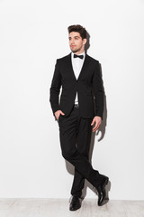 Full length portrait of a handsome young man