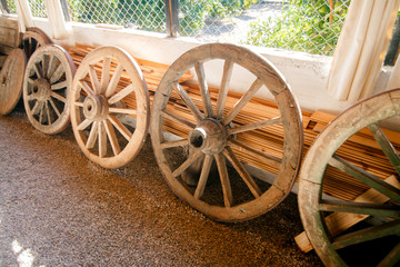 wooden wheels lined up in a row of different sizes