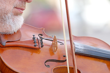 A man on the street plays a violin