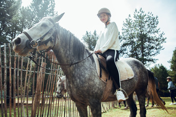 Pretty woman sitting on horse