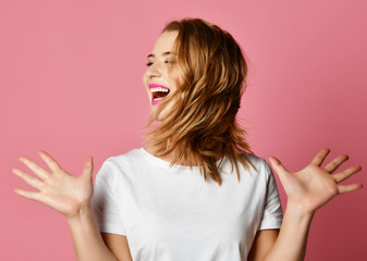 Emotional woman shake a head screaming shouting yelling closeup portrait on pink background