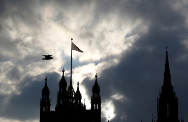 The silhouette of the Houses of Parliament is seen against a cloudy sky, in central London