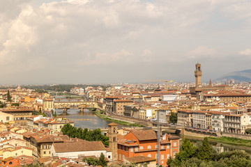 Cityscape of Florence, Italy. Beautiful view of Firenze with famous Ponte Vecchio bridge over the river Arno