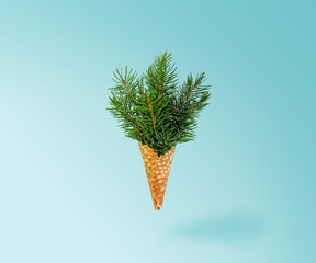 Christmas Tree Ice Cream Levitation on Ligth Blue Background. New Year Concept. Minimal Holiday Composition. Copy Space