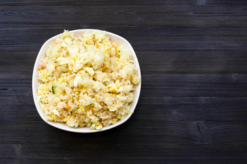 top view of Fried Rice in bowl on dark table